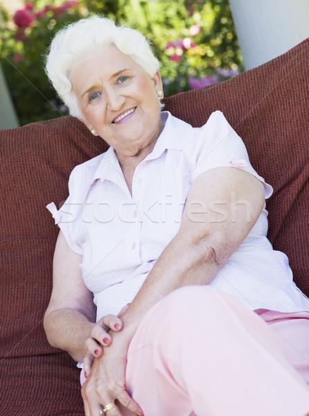 Senior woman sitting on garden chair Stock photo © monkey_business