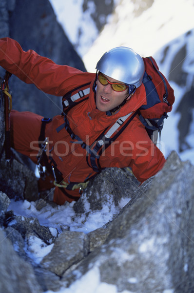 Jeune homme alpinisme pic escalade couleur montée Photo stock © monkey_business