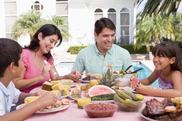 Stockfoto: Familie · genieten · barbecue · vrouw · man · tuin