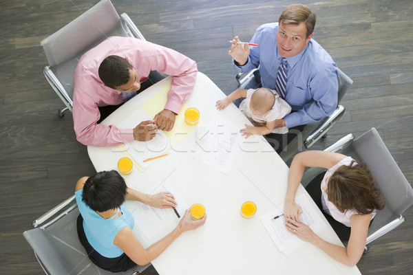 Four businesspeople in boardroom with one holding a baby Stock photo © monkey_business