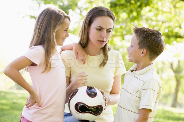 Woman and two young children outdoors holding volleyball and smi Stock photo © monkey_business