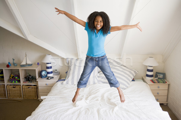 Young Girl Jumping On Her Bed Stock photo © monkey_business