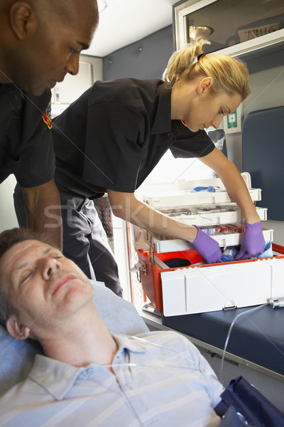 Paramedics with patient in ambulance Stock photo © monkey_business