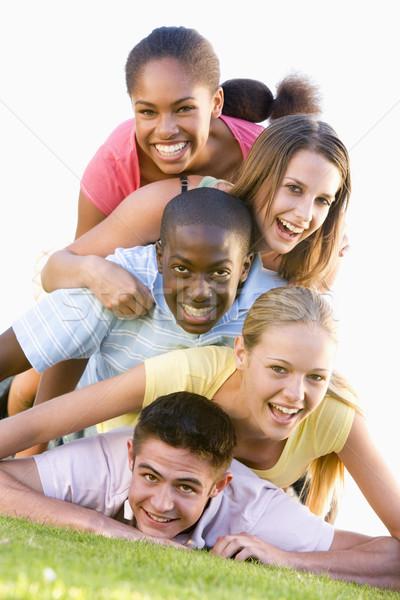 Gruppo adolescenti esterna amici parco Foto d'archivio © monkey_business