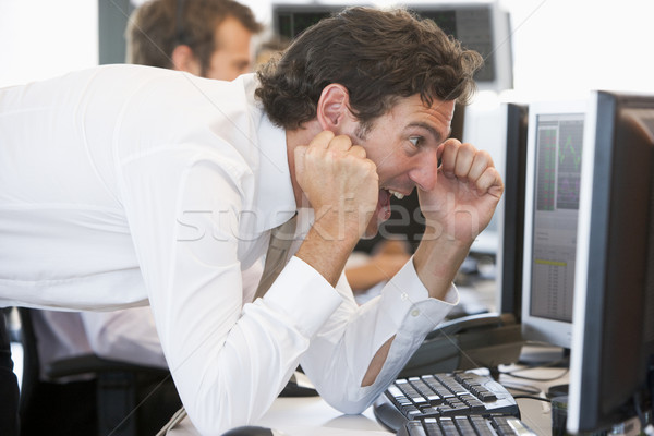 Stock Trader Overjoyed Looking At Monitor Stock photo © monkey_business