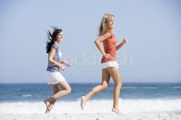 Two women running along beach Stock photo © monkey_business