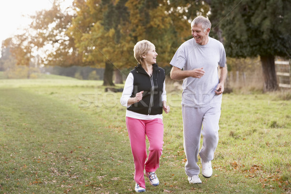 Senior Couple Power Walking In The Park Stock photo © monkey_business