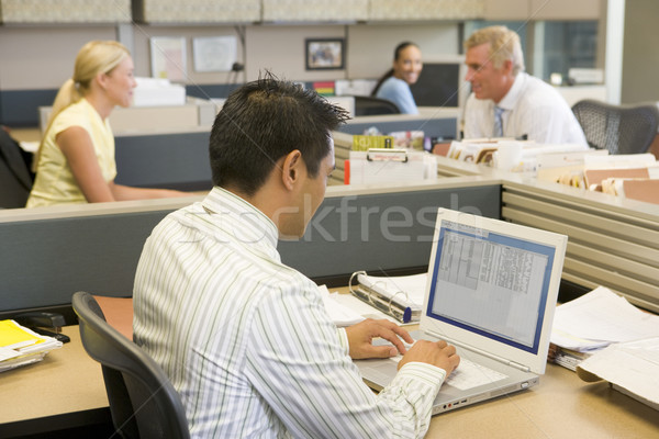 Businessman in cubicle at laptop Stock photo © monkey_business