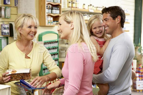 женщины продажи помощник здоровья продовольствие магазине Сток-фото © monkey_business