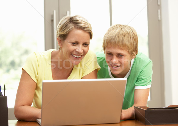 Mother And Teenage Son Using Laptop At Home Stock photo © monkey_business