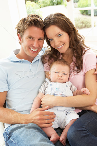 Parents Cuddling Newborn Baby Boy At Home Stock photo © monkey_business