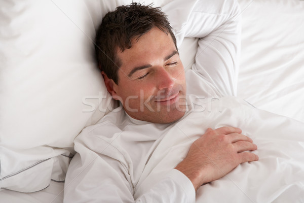 Stock photo: Man Sleeping Peacefully In Bed