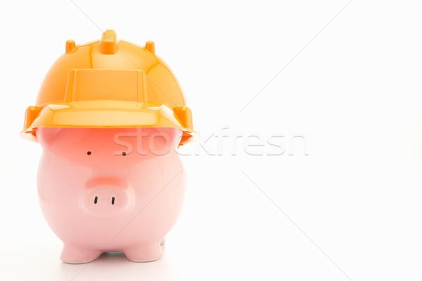 Piggybank with hard hat Stock photo © monkey_business