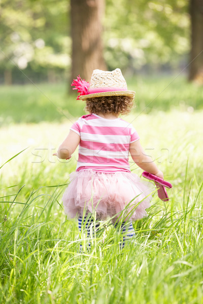 Young Girl In Summer Dress Sitting In Field Wearing Straw Hat Stock photo © monkey_business