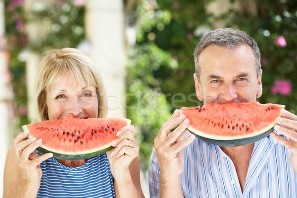 Genieten water meloen vrouw Stockfoto © monkey_business