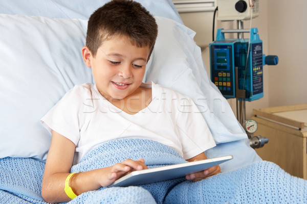 Boy Relaxing In Hospital Bed With Digital Tablet Stock photo © monkey_business