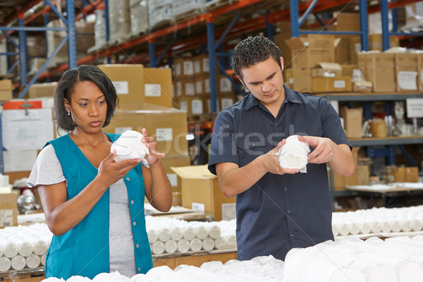Factory Workers Checking Goods On Production Line Stock photo © monkey_business