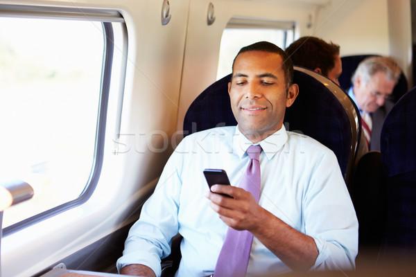 Stockfoto: Zakenman · woon-werkverkeer · werk · trein · mobiele · telefoon · man