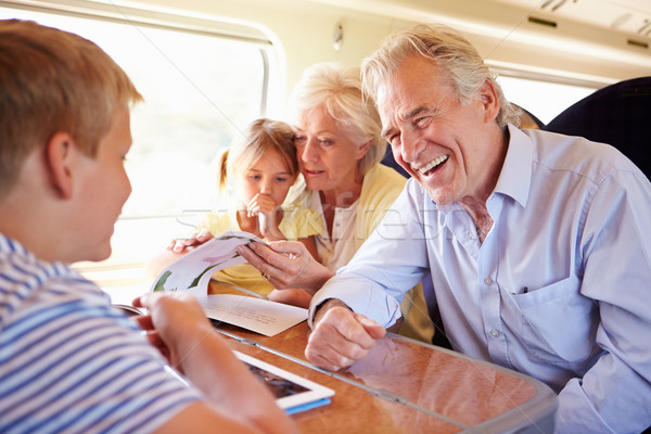 Grandparents And Grandchildren Relaxing On Train Journey Stock photo © monkey_business