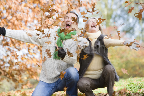 Senior couple throwing leaves in the air Stock photo © monkey_business