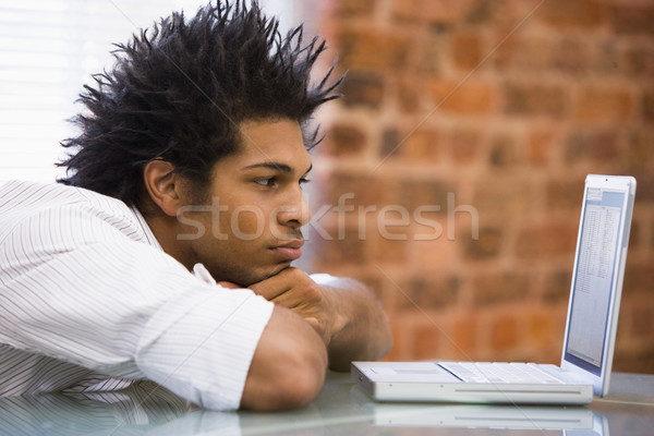 Stock photo: Businessman sitting in office with laptop