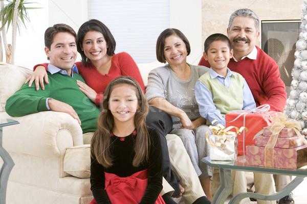 Família sessão em torno de mesa de café natal presentes Foto stock © monkey_business