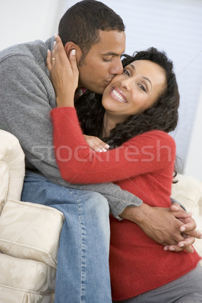 Couple in living room kissing and smiling Stock photo © monkey_business