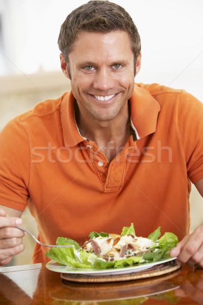 Középkorú férfi egészségesen enni étel étel férfi asztal Stock fotó © monkey_business