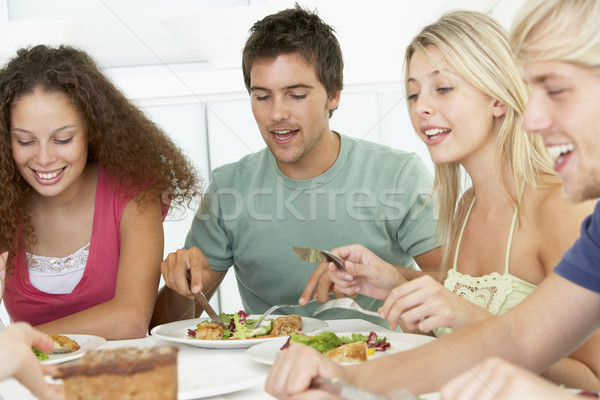Stock photo: Friends Having Lunch Together At Home