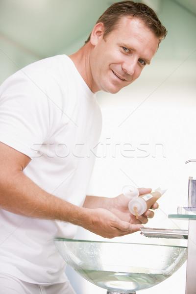 Homem banheiro cabelo gel sorridente sensual Foto stock © monkey_business
