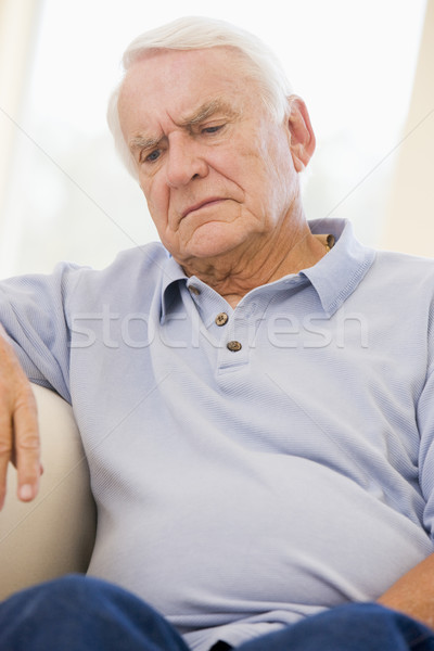 Altos hombre sesión sofá casa triste Foto stock © monkey_business