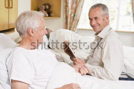 Orvos ül idős nő kórház orvosi Stock fotó © monkey_business