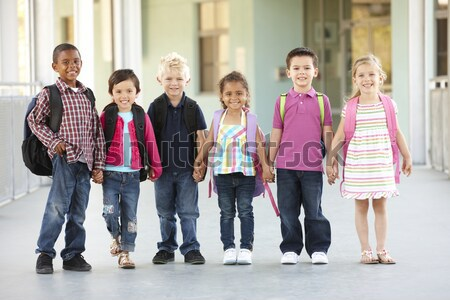 Teenage boys watching girls walk down a school corridor Stock photo © monkey_business