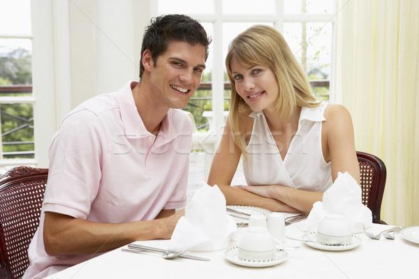 Stock fotó: Fiatal · pér · élvezi · hotel · étel · férfi · asztal