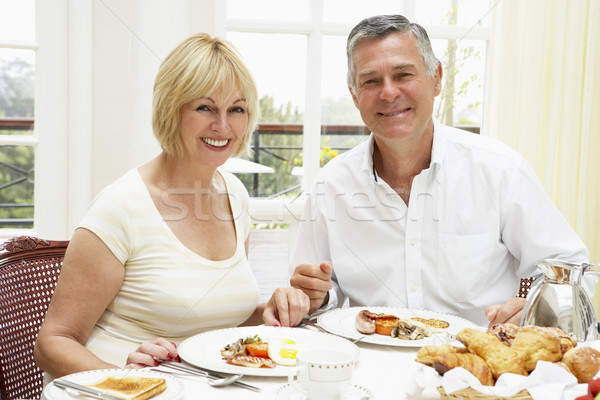 Paar genieten hotel ontbijt man Stockfoto © monkey_business