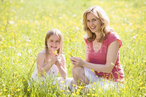 Madre hija aire libre flor sonriendo Foto stock © monkey_business