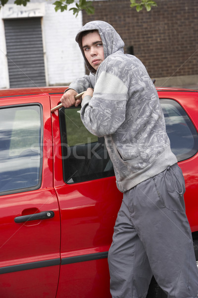 Young Man Breaking Into Car Stock photo © monkey_business