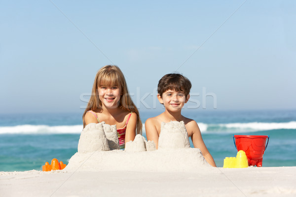Children Building Sandcastles On Beach Holiday Stock photo © monkey_business