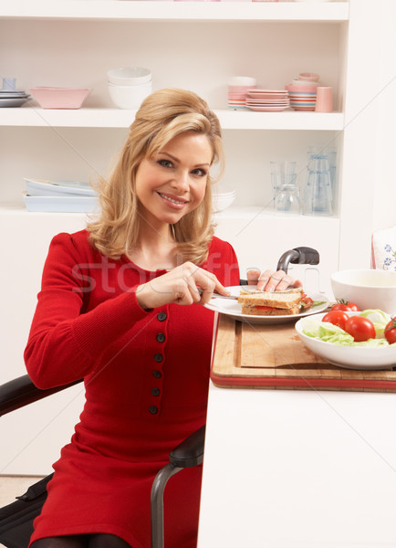 Disabled Woman Making Sandwich In Kitchen Stock photo © monkey_business