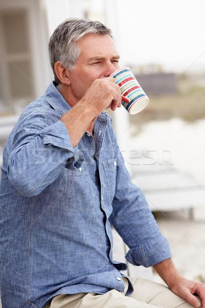 старший человека расслабляющая улице пляж кофе Сток-фото © monkey_business