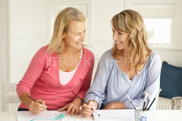 Mid age women painting with watercolors Stock photo © monkey_business