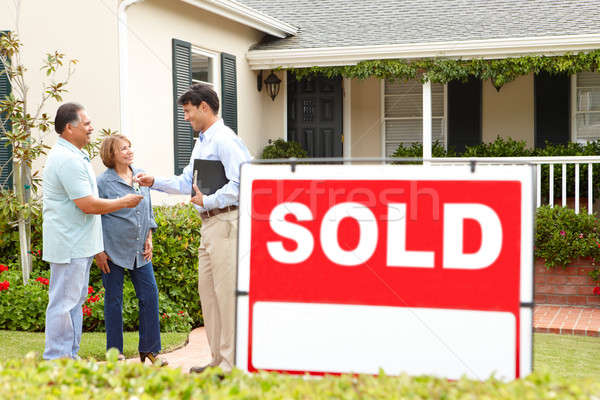 Senior Hispanic couple buying new home Stock photo © monkey_business