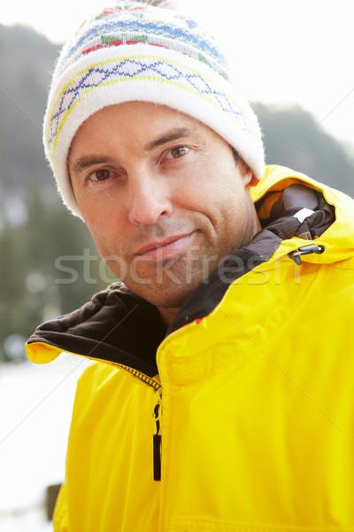 Középkorú férfi hideg időjárás boldog hegy sí Stock fotó © monkey_business