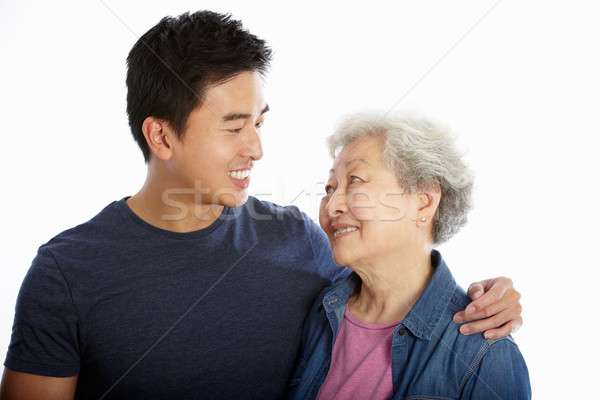 Studio Portrait Of Chinese Mother With Adult Son Stock photo © monkey_business