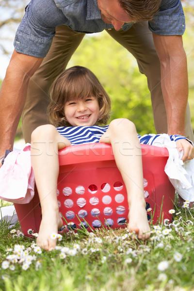 Padre figlio seduta cestino di lavanderia uomo Foto d'archivio © monkey_business