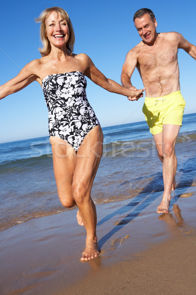 Senior Couple Enjoying Beach Holiday Stock photo © monkey_business