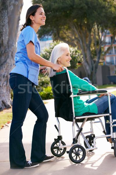 Gondozó toló idős nő tolószék nők Stock fotó © monkey_business