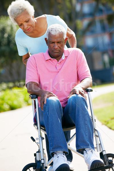 Senior Woman Pushing Unhappy Husband In Wheelchair Stock photo © monkey_business