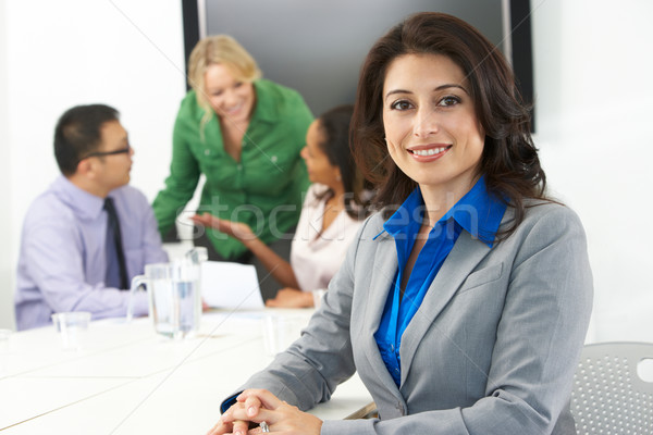 Portrait Of Businesswoman In Boardroom With Colleagues Stock photo © monkey_business