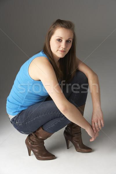 Tinilány térdel stúdió lány szín fiatal Stock fotó © monkey_business
